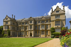 """The east front of Montacute House, Somerset. This Elizabethan Ham-stone house was built in the late sixteenth-century for Sir Edward Phelips. The east front is in the usual Elizabethan """"E"""" formation with projecting wings to either side and central frontispiece."""